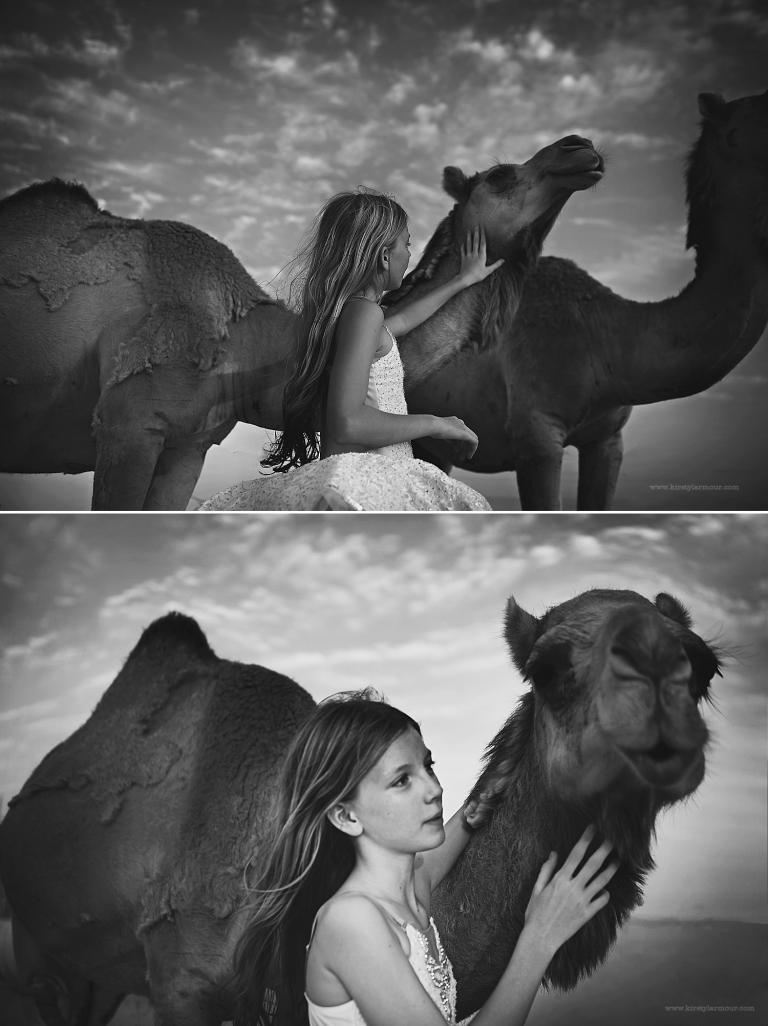 A girl talks to camels in the Abu Dhabi desert