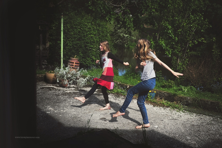 2 girls dancing together in their back yard in Yorkshire, England